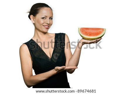 Portrait of smiling beautiful Asian woman holding watermelon in studio isolated on white background - stock photo