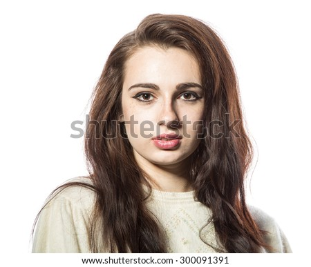 Portrait of smiling beautiful brunette model with freckles and long hair in yellow sweater. Front view. Isolated on a white background.