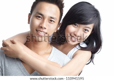 Portrait of smiling beautiful girl embracing her boyfriend - stock photo