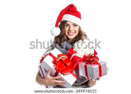 Portrait of smiling beautiful happy girl in christmas santa hat. Beauty woman isolated - stock photo