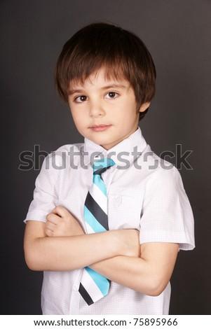 Portrait of smiling beautiful stylish little boy, studio shot - stock photo