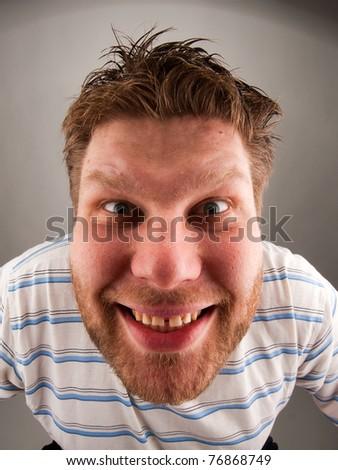 Portrait of smiling bizarre man making faces - stock photo