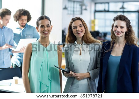 Portrait of smiling business executives at meeting in office