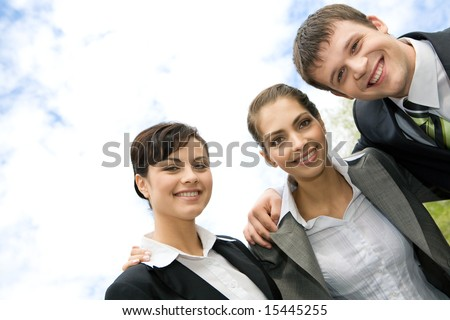 Portrait of smiling business group of people looking at camera