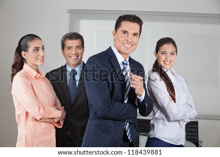 Portrait of smiling business office team with the arms crossed - stock photo