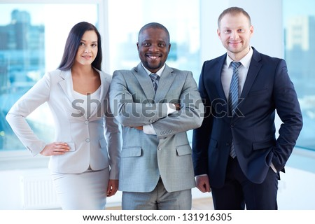 Portrait of smiling business partners looking at camera - stock photo