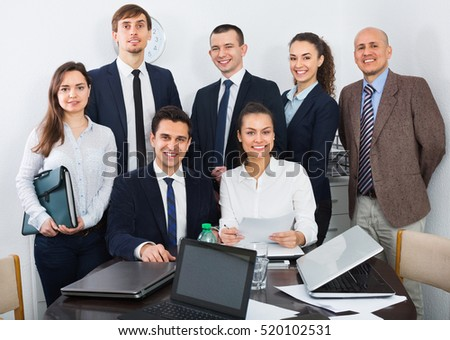Portrait of  smiling business specialist and secretary working in modern office