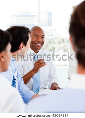 Portrait of smiling business team during a meeting in the office - stock photo