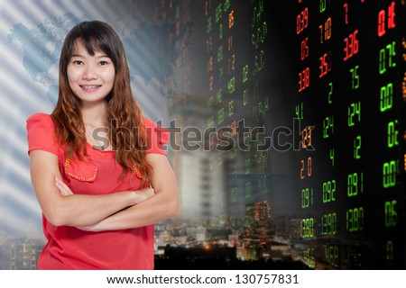 Portrait of smiling business woman . over stock exchange and buildings background - stock photo