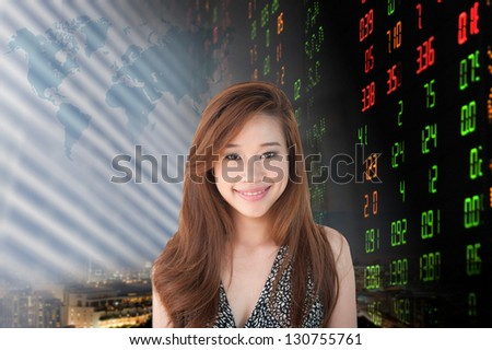 Portrait of smiling business woman . over stock exchange background