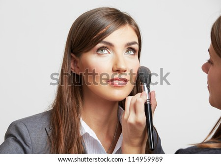 Portrait of smiling  business woman uses service of make up, isolated.