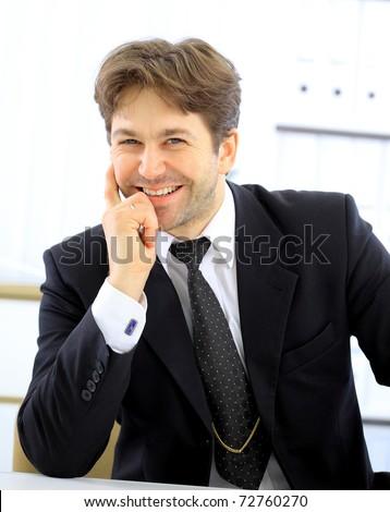 Portrait of smiling businessman - stock photo