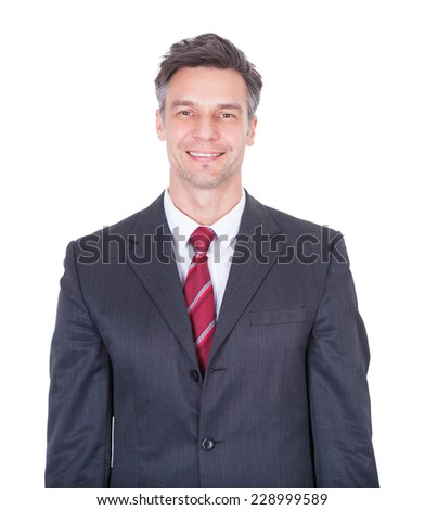 Portrait of smiling businessman against white background
