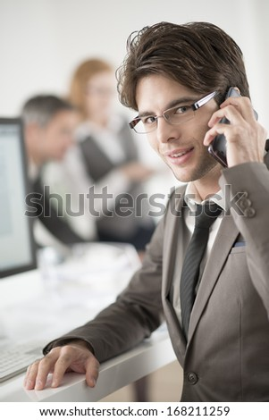 portrait of smiling businessman at phone