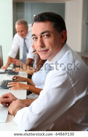 Portrait of smiling businessman in a meeting