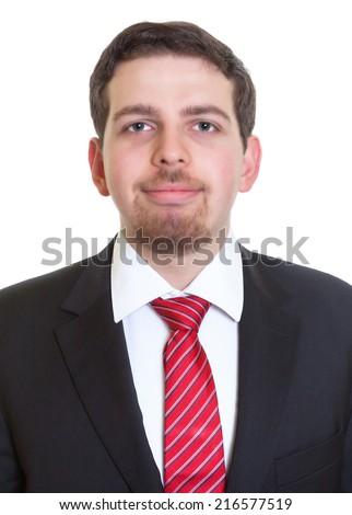 Portrait of smiling businessman in black suit - stock photo