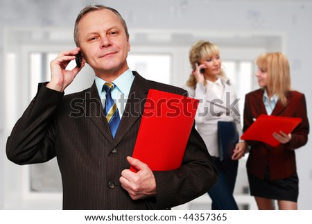 Portrait of smiling businessman with the working group. - stock photo