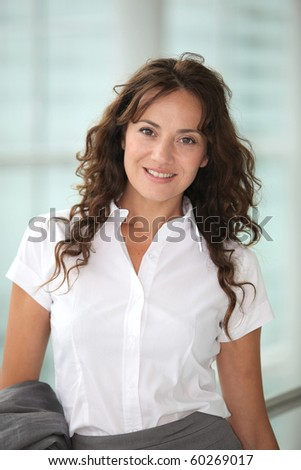 Portrait of smiling businesswoman - stock photo