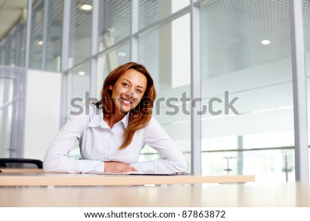 Portrait of smiling businesswoman at workplace