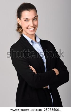 Portrait of smiling businesswoman. Studio shot - stock photo