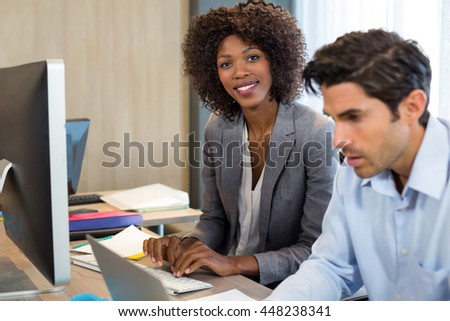 Portrait of smiling businesswoman working in office