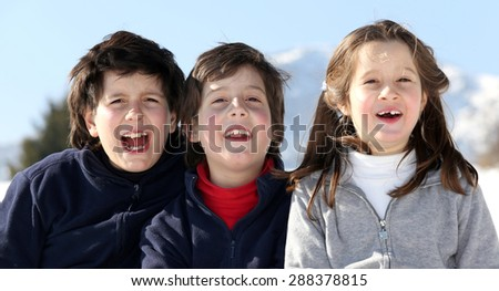 Portrait of smiling Caucasian three brothers in winter
