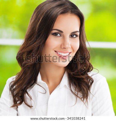 Portrait of smiling cheerful brunette businesswoman  - stock photo