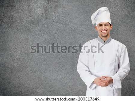 Portrait of smiling chef cook, isolated on grey background. Concept of restaurant business and tasty food - stock photo