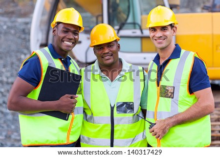 portrait of smiling construction workers - stock photo