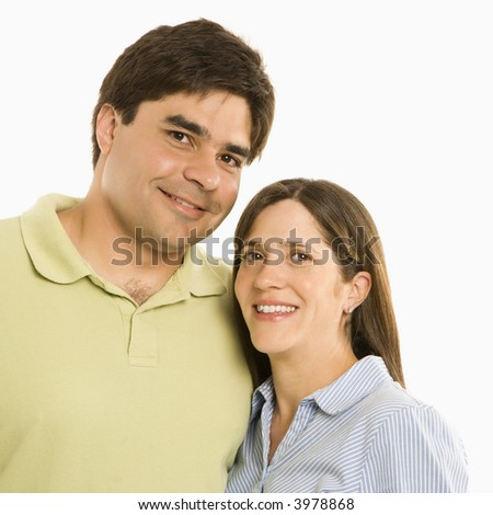 Portrait of smiling couple against white background.