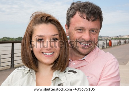 Portrait Of Smiling Couple near to the river on vacation tourism