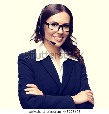 Portrait of smiling customer support phone operator in glasses - stock photo