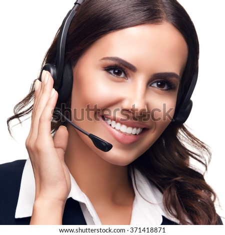 Portrait of smiling customer support phone operator, isolated against white background - stock photo
