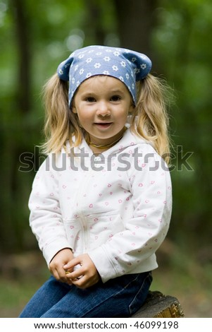 portrait of smiling cute little child outdoor