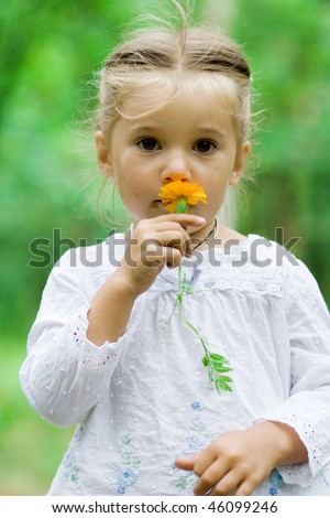 portrait of smiling cute little child outdoor - stock photo