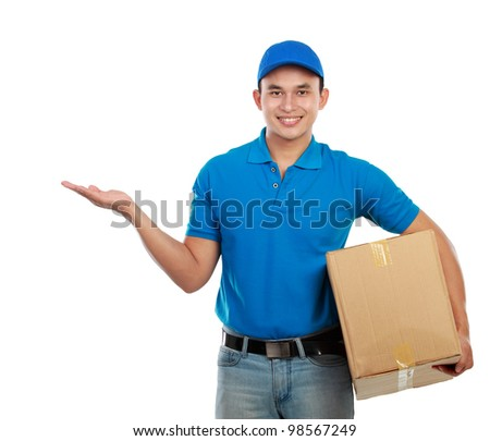 Portrait of smiling delivery man with package presenting something on white background - stock photo