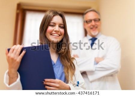Portrait of smiling doctors - stock photo