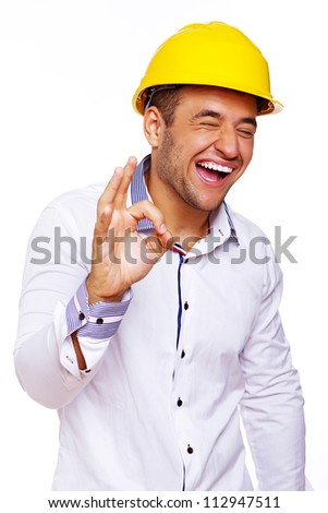 Portrait of smiling engineer posing in studio in helmet