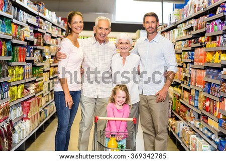 Portrait of smiling extended family at the supermarket - stock photo