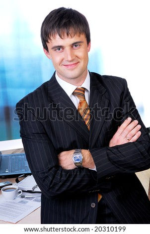Portrait of smiling face of a mid adult businessman in the office