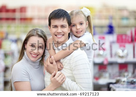 Portrait of smiling families at the store - stock photo
