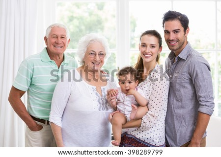 Portrait of smiling family with baby at home