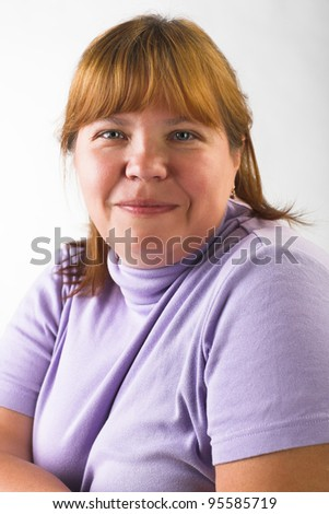 portrait of smiling fat woman on gray background - stock photo