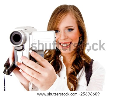 portrait of smiling female carrying videocamera on an isolated white background - stock photo