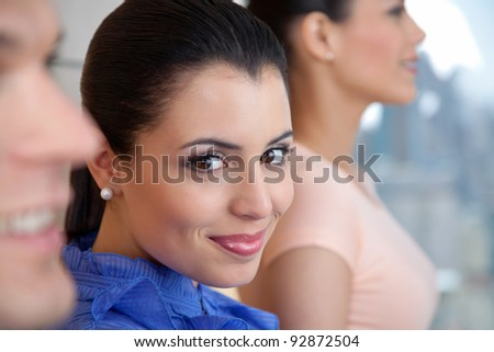 Portrait of smiling female executive standing with her colleagues - stock photo