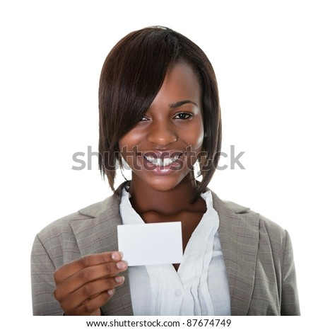 Portrait of smiling female executive with business card on white background.