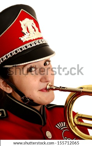 Portrait of smiling female teenager in  red and black marching band uniform with mellophone isolated on white background - stock photo