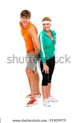 Portrait of smiling fit young woman and man in sportswear isolated on white - stock photo