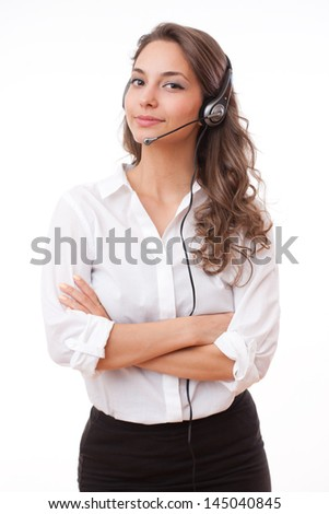 Portrait of smiling friendly office girl wearing headset. - stock photo