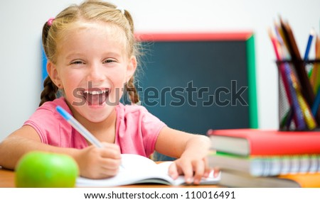 Portrait of smiling girl at workplace with the apple